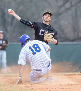 Crystal Lake Central second baseman Lucas Irwin turns a double play as Woodstock's Jacob Waryck is called for interference sliding into second base Friday, April 5, 2019 in Woodstock. Central went on to win 13-0 in five innings. KKoontz – For Shaw Media