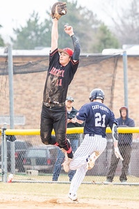 Huntley's Hunter Rumachik goes up high for the ball as Cary-Grove's Ryan Weaver reaches first base Saturday, April 6, 2019 in Cary. Cary would go on and take the win 4-3. KKoontz – For Shaw Media