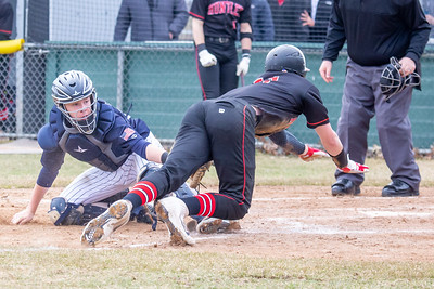 A close play at the plate as Huntley's Hunter Rumachik is called safe after a missed tag by Cary-Grove catcher Drew Stengren Saturday, April 6, 2019 in Cary. Cary wins 4-3 with a walk-off walk in the bottom of the seventh inning. KKoontz – For Shaw Media