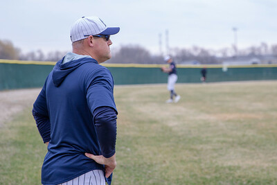 Cary-Grove head baseball coach Ryan Passaglia watches his team warm up before the game against Huntley Saturday, April 6, 2019 in Cary. Cary wins 4-3 with a walk-off walk in the bottom of the seventh inning. KKoontz – For Shaw Media