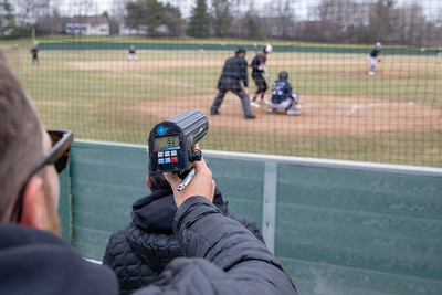 Ty Boyles, a scout for the St. Louis Cardinals, uses a radar gun to measure the speed of Quinn Priester's fastball during a game against Huntley Saturday, April 6, 2019 in Cary.  KKoontz – For Shaw Media