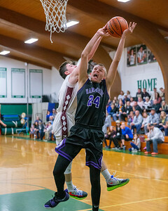 Hampshire's Justin Anderson has his shot blocked by Marengo's Jalen Ramsey at the 2019 McHenry County Boys Basketball All-Star game held at the Alden-Hebron Tigard Gymnasium Sunday, April 7, 2019 in Hebron. KKoontz – For Shaw Media