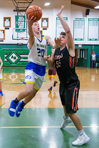 Johnsburg's Gibson Groves goes up for the basket over Crystal Lake Central's Alex Timmerman at the 2019 McHenry County Boys Basketball All-Star game held at the Alden-Hebron Tigard Gymnasium Sunday, April 7, 2019 in Hebron. KKoontz – For Shaw Media