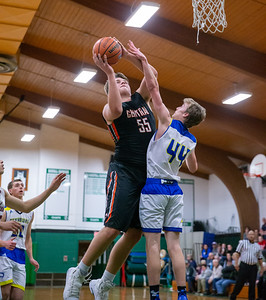 Crystal Lake Central's Alex Timmerman goes over Johnsburg's Jonny Preston for the basket at the 2019 McHenry County Boys Basketball All-Star game held at the Alden-Hebron Tigard Gymnasium Sunday, April 7, 2019 in Hebron. KKoontz – For Shaw Media
