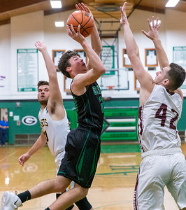 Alden-Hebron's Brad Johnson goes over Marengo's Brock Bertrand for the shot at the 2019 McHenry County Boys Basketball All-Star game held at the Alden-Hebron Tigard Gymnasium Sunday, April 7, 2019 in Hebron. KKoontz – For Shaw Media