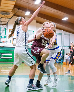 Marengo's Erin Haeflinger splits two defenders as she drives towards the basket at the 2019 McHenry County All-Star game held at Alden-Hebron's Tigard Gymnasium Sunday, April 7, 2019 in Hebron. KKoontz – For Shaw Media