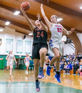 Crystal Lake Central's Maddie Haslow drives the lane against Dundee Crown's Shinah Walker at the 2019 McHenry County All-Star game held at Alden-Hebron's Tigard Gymnasium Sunday, April 7, 2019 in Hebron. KKoontz – For Shaw Media