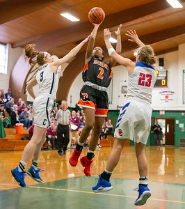 McHenry High School's Izzy Gscheidle splits a pair of defenders going up for a shot at the 2019 McHenry County All-Star game held at Alden-Hebron's Tigard Gymnasium Sunday, April 7, 2019 in Hebron. KKoontz – For Shaw Media