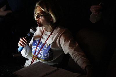 Candace H. Johnson-For Shaw Media Beth Suehr, director, sits in the back of the theater with a microphone helping students on stage during the dress rehearsal for The Sound of Music at Grant Community High School in Fox Lake. The musical will be held at Grant on Friday, April 12th at 7:00 pm., Saturday, April 13th, at 7:00 pm. and Sunday, April 14th at 2:00 pm. (4/8/19)