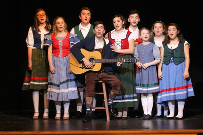 Candace H. Johnson-For Shaw Media Captain Georg von Trapp (Sam Winters) and Maria Rainer (Madison Hartman), both center, sing with the von Trapp children during the dress rehearsal for The Sound of Music at Grant Community High School in Fox Lake. The musical will be held at Grant on Friday, April 12th at 7:00 pm., Saturday, April 13th, at 7:00 pm. and Sunday, April 14th at 2:00 pm. (4/8/19)