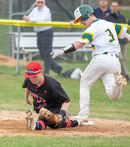 Huntley first baseman Josh Tarlin digs the ball out of the dirt in time to get the force out on Crystal Lake South's Kyle Green Wednesday, April 17, 2019 in Crystal Lake. Huntley went on to win 7-5. KKoontz – For Shaw Media