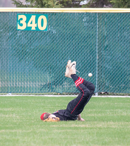 Huntley right fielder Andrew Henkle dives for a ball against Crystal Lake South Wednesday, April 17, 2019 in Crystal Lake. Huntley went on to win 7-5. KKoontz – For Shaw Media