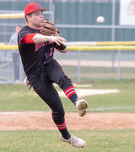 Huntley's Jackson Broom fields a bunt and makes the throw to first against Crystal Lake South Wednesday, April 17, 2019 in Crystal Lake. Huntley went on to win 7-5. KKoontz – For Shaw Media