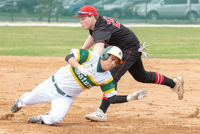 Huntley first baseman Josh Tarlin tags Crystal Lake South's Patrick Fischer for the second out of a double play in the bottom of the first inning Wednesday, April 17, 2019 in Crystal Lake. Huntley went on to win 7-5. KKoontz – For Shaw Media
