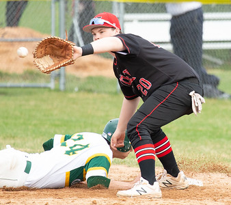 Crystal Lake South's Nicholas Mannella dives back into first as Huntley first baseman Josh Tarlin catches the pick-off attempt Wednesday, April 17, 2019 in Crystal Lake. Huntley went on to win 7-5. KKoontz – For Shaw Media