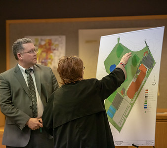 McHenry resident Gail Riddle (right) expresses her concerns over the expansion of McHenry West High School at the McHenry Planning and Zoning meeting held Wednesday, April 17, 2019 in McHenry.  KKoontz – For Shaw Media