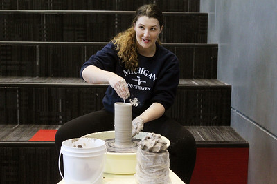 Candace H. Johnson-For Shaw Media Lakes Kara Boudart, 18, of Lindenhurst competes against Antioch in the 4th Annual Mud Olympics as she looks up while making the tallest pot out of clay to win during the District 117 Art Show at Lakes Community High School in Lake Villa. The event was sponsored by the Antioch Women's Club. (4/12/19)