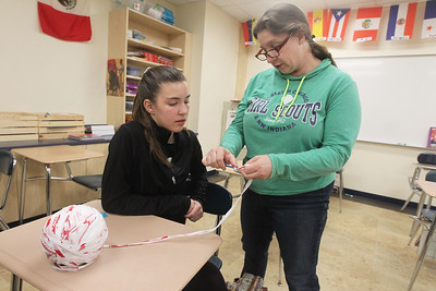 Candace H. Johnson-For Shaw Media Arwen Townander, 14 of Libertyville learns how to crochet plastic yarn to make a reusable shopping bag made from strips of used Target bags by her Girl Scout Leader, Nancy Fink, both of Libertyville during a Girl Scout Troop 40933 meeting at Oak Grove School in Libertyville. The project was assigned in honor of Earth Day. (4/10/19)