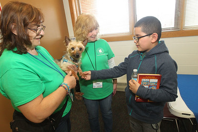 Candace H. Johnson-For Shaw Media Deb Bruser, of Park City and Linda Spadaro, of Ingleside, volunteers with Save-A-Pet in Grayslake talk to Sebastian Garcia, 9, of Round Lake about Nugget, a thirteen-year-old Yorkshire Terrier, up for adoption during the Pet Expo at the Round Lake Area Public Library. (4/13/19)