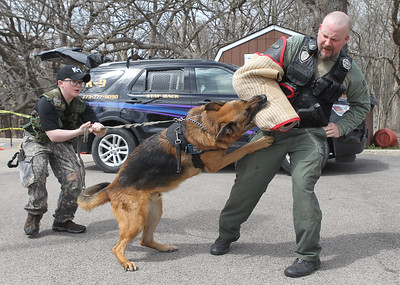 Candace H. Johnson-For Shaw Media Terry Kaminski, Jr., 12, of Lake Villa helps his father, Terry, give a K-9 Demonstration with their German Shepherd named, Ruger, during the Pet Expo at the Round Lake Area Public Library. Terry Kaminski is a canine officer with Seldin Security. (4/13/19)
