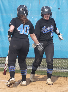 Candace H. Johnson-For Shaw Media Lakes Emily Cain congratulates Grace Goodlich on scoring against Antioch in the second inning at Lakes Community High School in Lake Villa. Antioch won 9-3. (4/16/19)