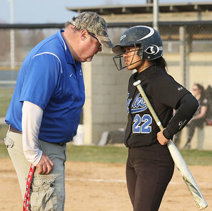 Candace H. Johnson-For Shaw Media Lakes Bill Hamill, head coach, talks with Kelsey Ulrich before batting against Antioch in the sixth inning at Lakes Community High School in Lake Villa. Antioch won 9-3. (4/16/19)