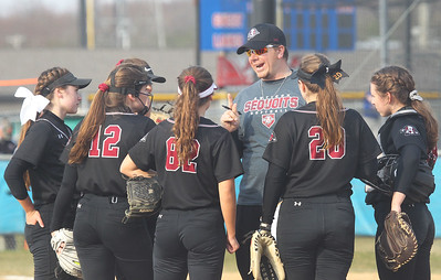 Candace H. Johnson-For Shaw Media Antioch's Anthony Rocco, head coach, talks with his varsity softball players in the second inning against Lakes at Lakes Community High School in Lake Villa. Antioch won 9-3. (4/16/19)