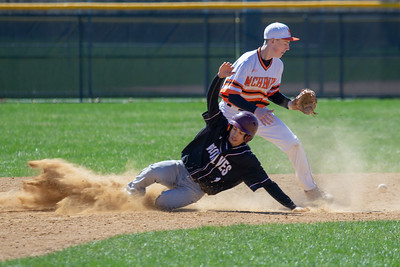 Prairie Ridge's Michael Patterson slides into second base against McHenry Saturday, April 20, 2019 in McHenry. Prairie Ridge goes on to win, 8-0. KKoontz- For Shaw Media