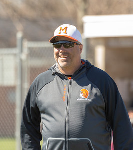 McHenry head baseball coach Brian Rockweller smiles after a conversation with the umpire during the game against Prairie Ridge Saturday, April 20, 2019 in McHenry. McHenry falls to Prairie Ridge, 8-0. KKoontz- For Shaw Media