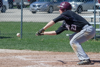 Prairie Ridge's Christopher Rafford drives in a run on a bases-loaded bunt in the top of the fifth inning against McHenry Saturday, April 20, 2019 in McHenry. Prairie Ridge goes on to win, 8-0. KKoontz- For Shaw Media