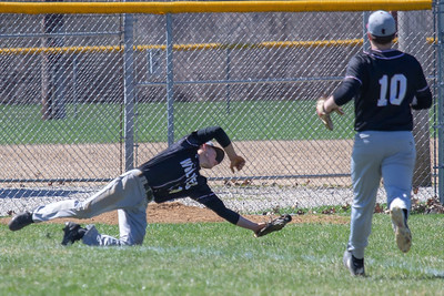 Prairie Ridge's Jared Lindquist makes a diving catch in right field against McHenry Saturday, April 20, 2019 in McHenry. Prairie Ridge goes on to win, 8-0. KKoontz- For Shaw Media