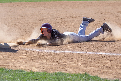 Prairie Ridge's Jacob Reichert slides into third against McHenry Saturday, April 20, 2019 in McHenry. Prairie Ridge goes on to win, 8-0. KKoontz- For Shaw Media