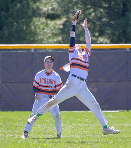 McHenry left fielder Jake Evans makes a running grab in the game against Prairie Ridge Saturday, April 20, 2019 in McHenry. Prairie Ridge goes on to win, 8-0. KKoontz- For Shaw Media