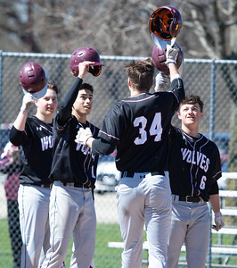 Prairie Ridge's teammates congratulate Keegan Garis (center) after he drove a two-run homerun over the right field fence against McHenry Saturday, April 20, 2019 in McHenry. Prairie Ridge goes on to win, 8-0. KKoontz- For Shaw Media