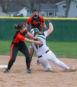 Crystal Lake South's Emily Sulikowski appears to have been tagged by Crystal Lake Central's Bailey Wydra, but is called safe on the play Monday, April 22, 2019 at Crystal Lake South High School. South goes on to win their 18th of the year, 12-2 in five innings. KKoontz- For Shaw Media