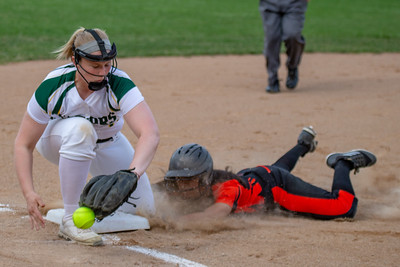 Crystal Lake Central's Jessica Cruz slides into third base ahead of the tag by Crystal Lake South's Emily Sulikowski Monday, April 22, 2019 at Crystal Lake South High School. South goes on to win their 18th of the year, 12-2 in five innings. KKoontz- For Shaw Media