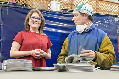 Former Illinois Lt. Governor Evelyn Sanguinetti (left) talks with Illinois Blower employee Sam Fregoso during a plant tour Monday, April 22, 2019 in Cary. Earlier in the day, Sanguinetti announced her run for Congress in Illinois' Sixth district. KKoontz – For Shaw Media