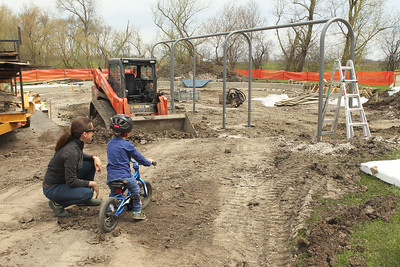 Candace H. Johnson-For Shaw Media Lehla Dannenmaier, of Grayslake and her son, Jack, 2, look at the playground being replaced at the Grayslake Community Park District's Sunrise Park in Grayslake. (4/22/19)