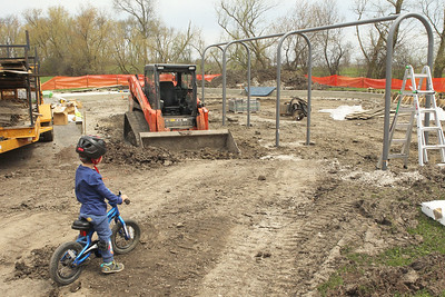 Candace H. Johnson-For Shaw Media Jack Dannenmaier, 2, of Grayslake stops to look at the playground being replaced at the Grayslake Community Park District's Sunrise Park while riding his bike in Grayslake. Jack was at the playground with his mother, Lehla. (4/22/19)