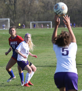 Candace H. Johnson-For Shaw Media Wauconda's Amyna Ribar (#5) throws the ball to Dakota Thompson (#3) against Lakes Abbey Findlay in the first half at Lakes Community High School in Lake Villa. Wauconda won 5-0. (4/23/19)