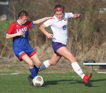 Candace H. Johnson-For Shaw Media Lakes Zoe Kane battles for control against Wauconda's Rosalie Wisniewski in the second half at Lakes Community High School in Lake Villa. Wauconda won 5-0. (4/23/19)