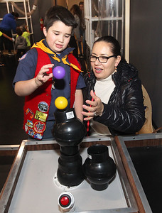 Candace H. Johnson-For Shaw Media Benjamin Flory, 8, of Fox Lake with Cub Scout Troop 179 and his mother, Yesenia, play with a Bernoulli Blower at the Kohl Children's Pop-Up Museum at the Village of Round Lake Beach Cultural & Civic Center. The Pop-Up Museum is open Thursdays 5-7 p.m. and Saturdays 10 a.m. - 4 p.m. It will run through May 25th.  (4/18/19)