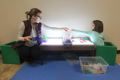 Candace H. Johnson-For Shaw Media Tara Rahn, of Round Lake and her daughter, Amelia, 5, play at the light table in the Kohl Children's Pop-Up Museum at the Village of Round Lake Beach Cultural & Civic Center. The Pop-Up Museum is open Thursdays 5-7 p.m. and Saturdays 10 a.m. - 4 p.m. It will run through May 25th.  (4/18/19)