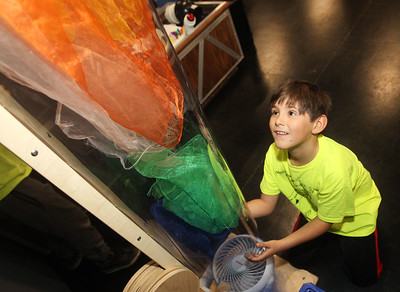 Candace H. Johnson-For Shaw Media Daniel Zander, 7, of Ingleside with Cub Scout Troop 179 puts handkerchiefs in an air tube at the Kohl Children's Pop-Up Museum at the Village of Round Lake Beach Cultural & Civic Center. The Pop-Up Museum is open Thursdays 5-7 p.m. and Saturdays 10 a.m. - 4 p.m. It will run through May 25th.  (4/18/19)