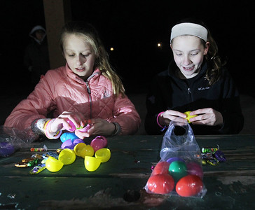 Candace H. Johnson-For Shaw Media Tinley Carbonell and Isabelle Streit, both 12, of Antioch open up the plastic eggs they found to find candy and prize slips during the Teen Flashlight Egg Hunt at Centennial Park in Antioch.  (4/18/19)