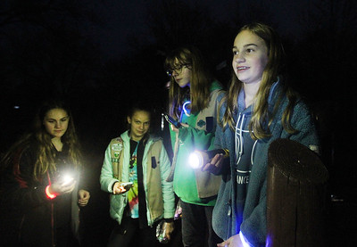 Candace H. Johnson-For Shaw Media Cadets Kaitlyn Satenstein, Keira Nelson, Madison Murata and Kaitlyn Leverenz, all 12, of Lindenhurst with Girl Scout Troop 40138 use their flashlights to look for plastic eggs with candy and prize slips in them during the Teen Flashlight Egg Hunt at Centennial Park in Antioch.The event was sponsored by the Village of Antioch's Park & Recreation.  (4/18/19)