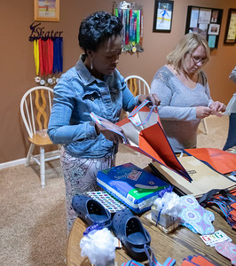 Dina Amoo, organizer of the charity Girls 4 Ghana, prepares bags of supplies for women in Ghana, Sunday, April 28, 2019 in Algonquin. G4G is preparing for a trip to Ghana in which they will be delivering feminine hygiene products and other necessities to those in need. KKoontz – For Shaw Media