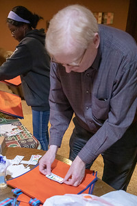 Volunteer Peter Nelson readies a bag to be filled with supplies for women in Ghana, Sunday, April 28, 2019 in Algonquin. The group, Girls 4 Ghana, is preparing for a trip to Ghana in which they will be delivering feminine hygiene products and other necessities to those in need. KKoontz – For Shaw Media