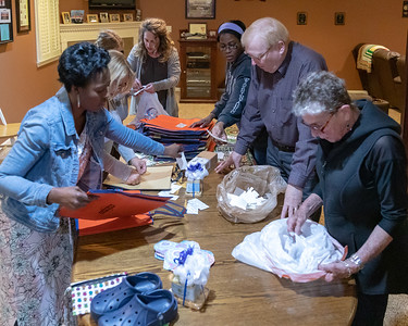Volunteers for the charity Girls 4 Ghana, prepare bags of supplies for women in Ghana Sunday, April 28, 2019 in Algonquin. G4G is preparing for a trip to Ghana in which they will be delivering feminine hygiene products and other necessities to those in need. KKoontz – For Shaw Media