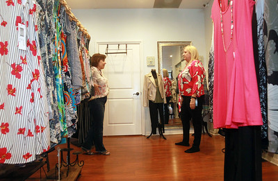 Candace H. Johnson-For Shaw Media Bonnie Schulz, owner, helps Jill Lueders, of Grayslake look at the fit on a pink top she was trying on at Bonnie's Chic Boutique in Grayslake. Jill Lueders shops at the boutique twice a week and enjoys their customer service. Due to Covid-19, the store is open by appointment only. (3/31/20)
